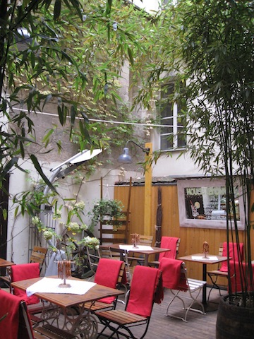 Inner courtyard turned into an inviting outdoor seating area - Prague, Czech Republic